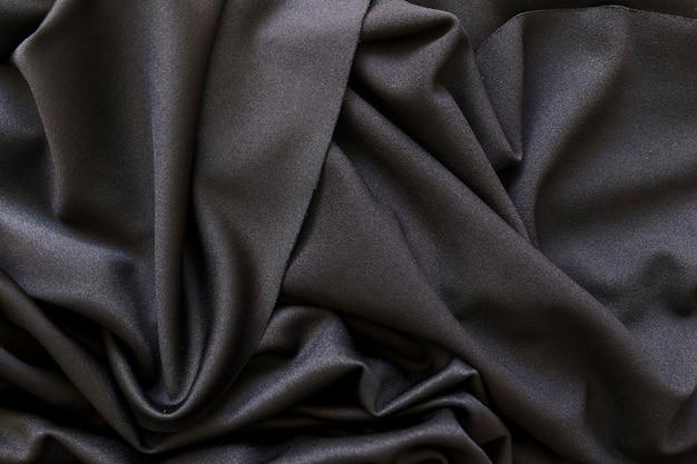Tiro de quadro completo de tecido preto liso