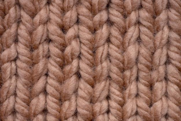 Tiro macro de textura de tecido de malha de lã marrom.