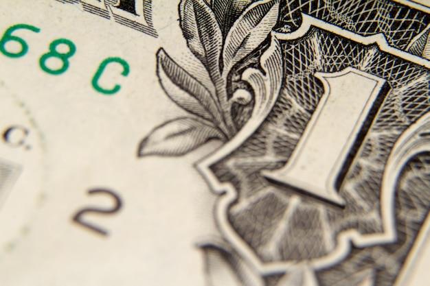 Tiro macro extremo de uma nota de um dólar, foco seletivo