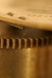Tiro marcro relógio velho, metais