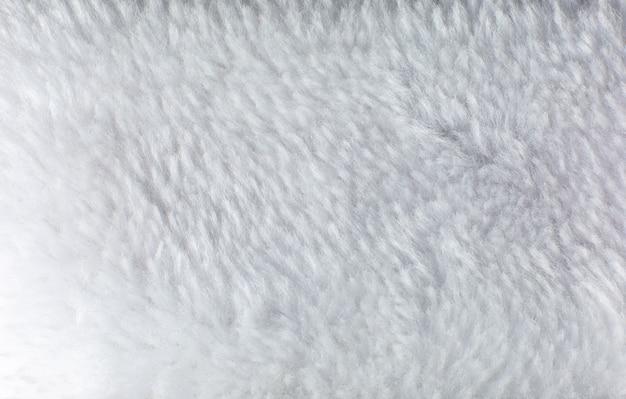 Toalha de algodão branco ou fundo de textura fofa do tapete. feche a foto.