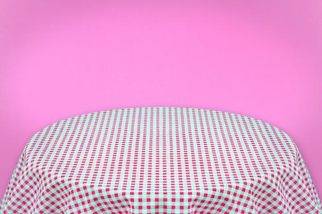 Toalha de mesa rosa com fundo rosa. fundo para texto simples ou produtos