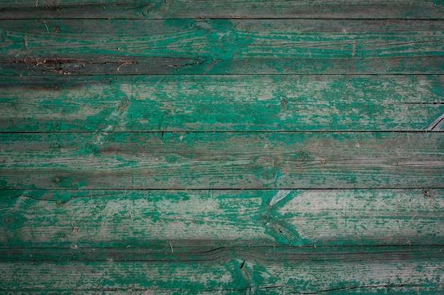 Toras de madeira de uma velha casa. fechar-se. textura de madeira verde resistida. fundo. foto vertical horizontal. foto de alta qualidade