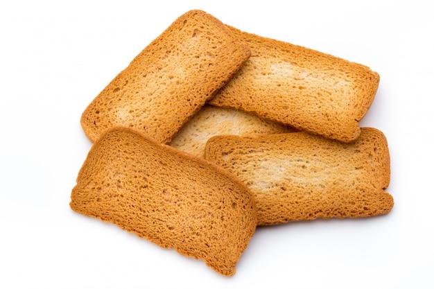 Torrar o pão isolado no branco.
