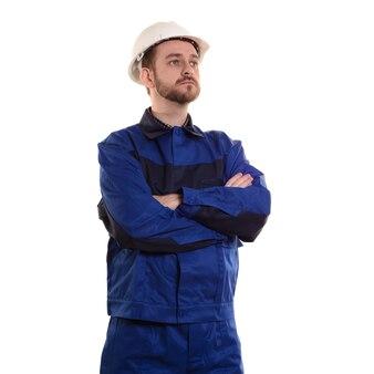Trabalhador da construção civil engenheiro-construtor com um capacete protetor branco