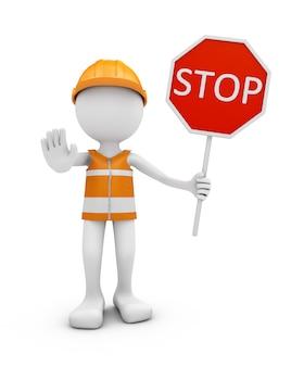 Trabalhador da estrada com sinal do capacete e de tráfego pare.