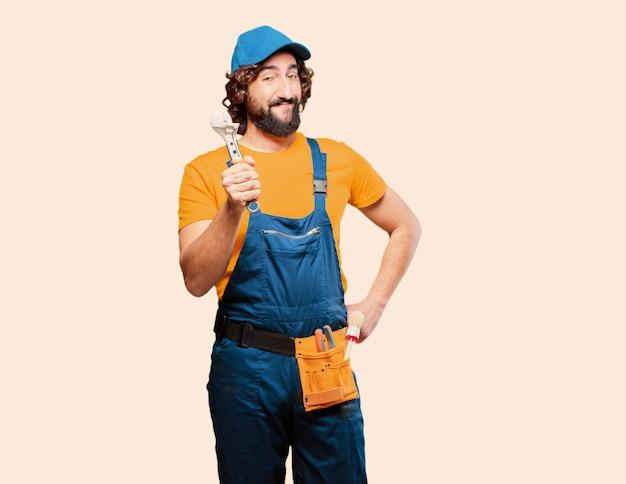 Trabalhador de trabalhador manual segurando uma chave
