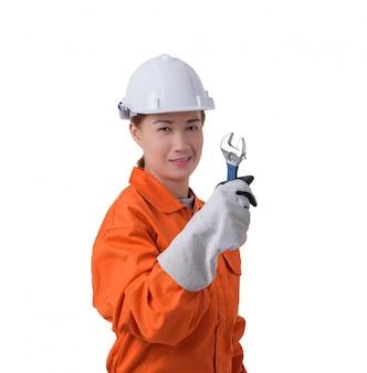 Trabalhador mulher, em, mecânico, jumpsuit, é, segurando, um, chave, isolado, branco, fundo