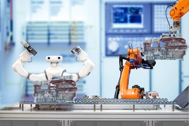 Trabalho em equipe robótico industrial trabalhando com peças de motor de moto via transportadora na fábrica inteligente turva azul