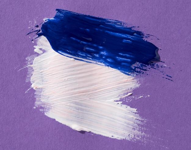 Traçados de pincel branco e azul