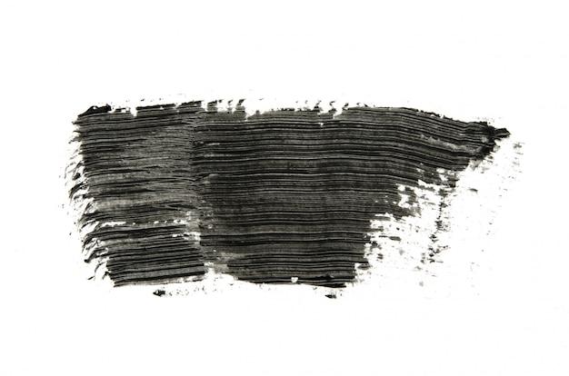 Traçados de pincel de rímel preto isolados no branco