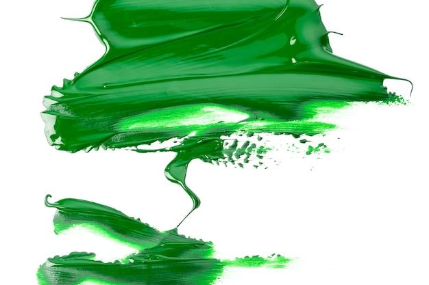 Traço verde do pincel em papel branco