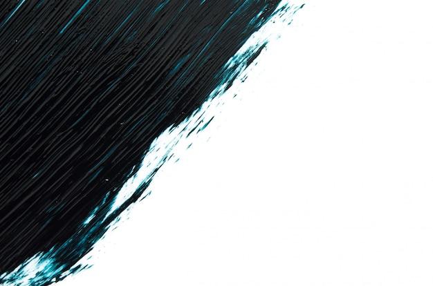 Traços de índigo e rímel de textura ou acrílico em um fundo branco.