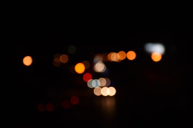 Tráfego de luz noite bokeh