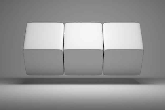Três cubos grandes brancos