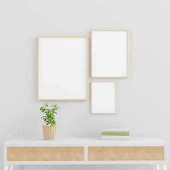 Três molduras em branco em uma parede com console com planta verde e maquete mínima de livros renderização em 3d