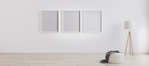 Três molduras em branco na parede. insira sua foto. interior moderno da sala de estar