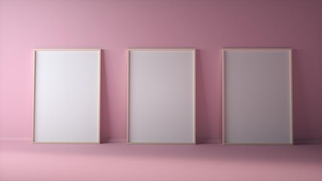 Três molduras em branco na parede rosa claro simulado