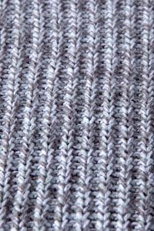Tricô sem costura padrão. lã cinza. malha artesanal velha
