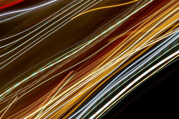 Trilhas de luz abstrata da noite.