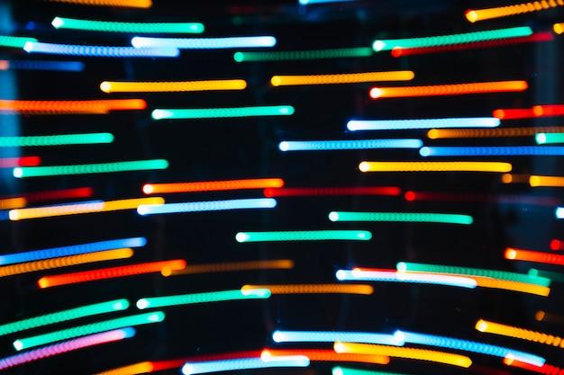 Trilhas de pontos coloridos de luz