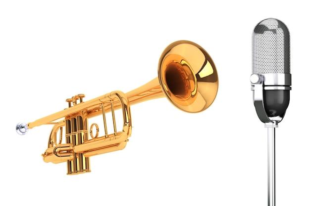 Trompete de latão polido com microfone de prata vintage em um fundo branco