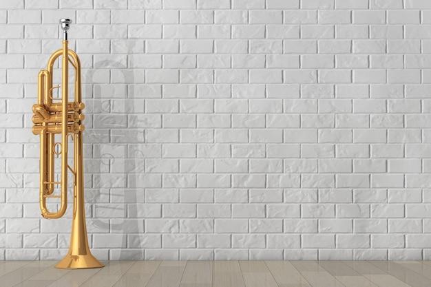 Trompete de latão polido em frente à parede de tijolos