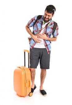 Turista com dor de estômago