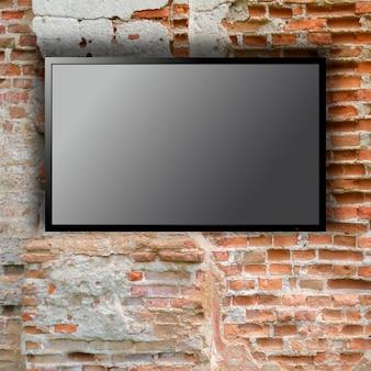 Tv em branco na parede de tijolos com espaço de cópia