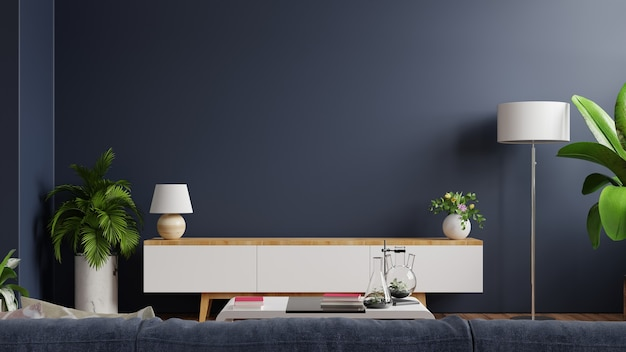 Tv gabinete na sala vazia moderna com atrás da parede azul escura. renderização 3d