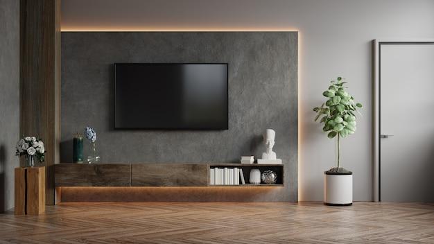 Tv montada na parede em uma sala escura com renderização 3d em parede de concreto