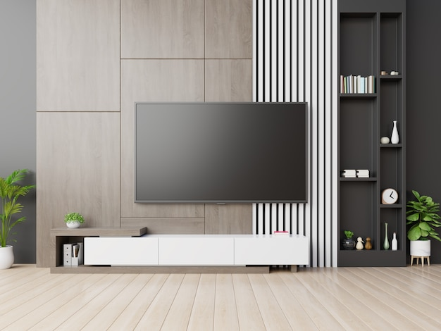 Tv na parede tem armário no quarto vazio moderno com parede de madeira.