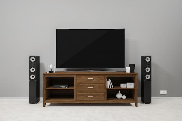 Tv na tv prateleira de madeira e alto-falantes