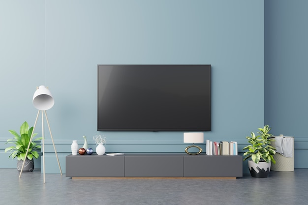 Tv no armário na moderna sala de estar na parede azul escuro