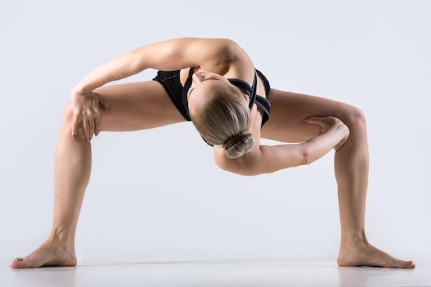 Twisting sumo squat pose