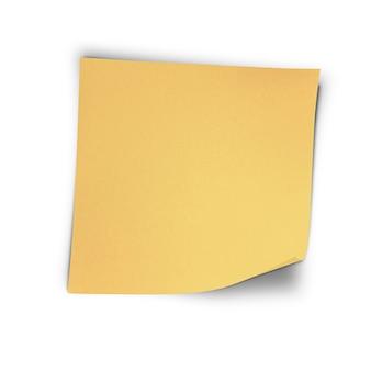 Um adesivo amarelo na parede branca isolada