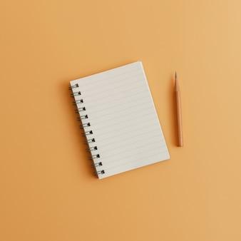 Um bloco de notas em branco com o lápis no fundo marrom da cor com espaço da cópia. estoque conservado em estoque para meios sociais.