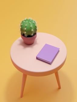 Um cacto e um livro sobre a mesa.