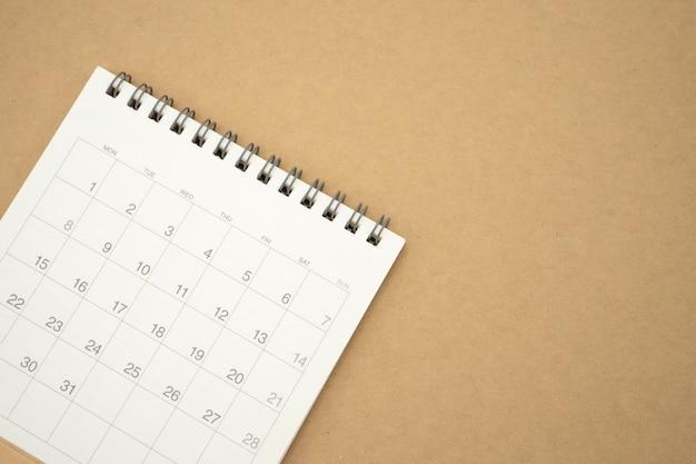 Um calendário do mês. usando como plano de fundo o conceito e o planejamento de negócios