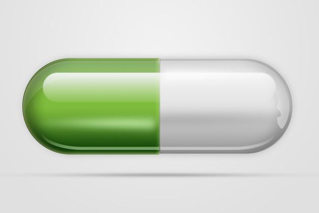Um comprimido em cápsulas de cor verde, uma luz