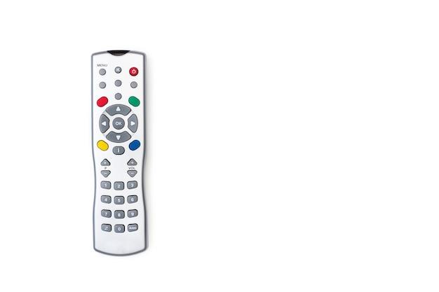 Um controle remoto de tv cinza isolado em um fundo branco com espaço de cópia