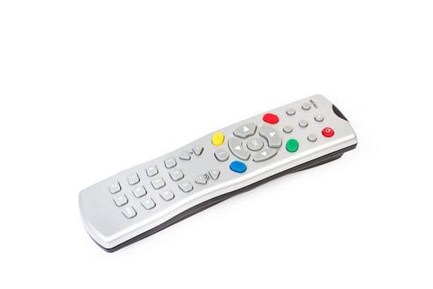 Um controle remoto de tv cinza isolado em um fundo branco com espaço de cópia Foto Premium