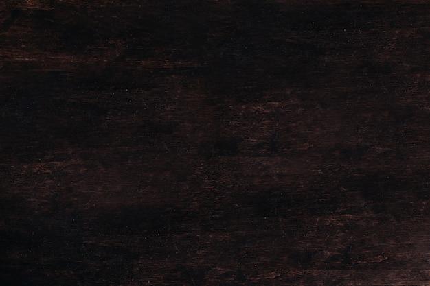 Um de madeira uma tabela de madeira marrom. textura escura de madeira do fundo.