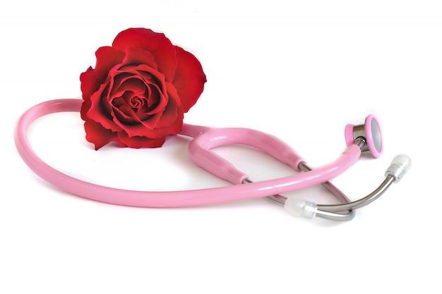Um estetoscópio rosa e uma rosa vermelha