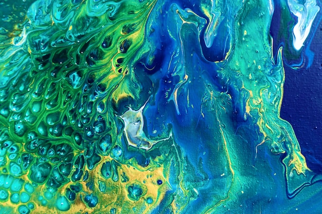 Um fundo de acrílico bonito em cores verdes e azuis. textura colorida abstrata, papel de parede, plano de fundo para design e criatividade. mistura de cores, arte moderna. fluid art.