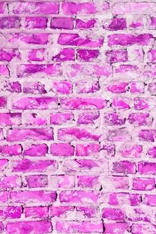 Um fundo de textura abstrata de tijolo rosa. parede de tijolos