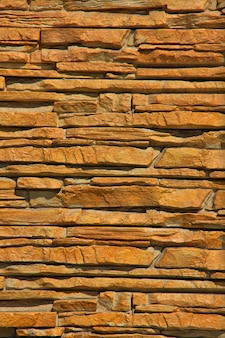 Um fundo de textura de parede de pedra empilhada