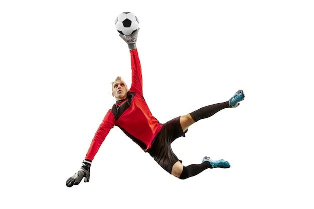 Um goleiro jogador de futebol pegando a bola