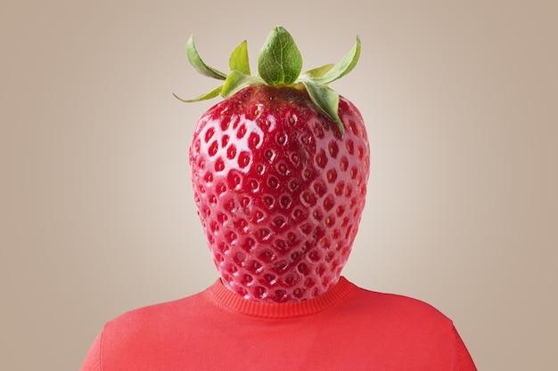 Um homem com um morango em vez de cabeça