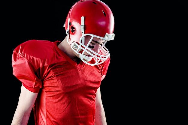 Um, jogador football, levando, seu, capacete, ligado, dela, cabeça